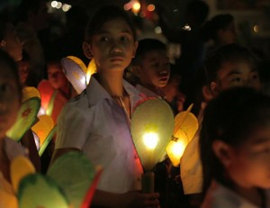 School Children, faces lit by lantern