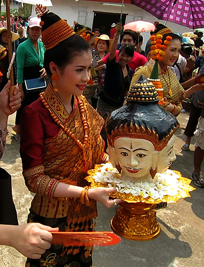 "Ka Bin La Phom is carried by the current Miss ""Lao New Year"" at Wat Mahathat"