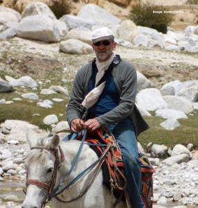 Riding a pony to Chosser, north of Lo Manthang, Nepal